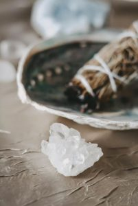 crystal and sage in a bowl